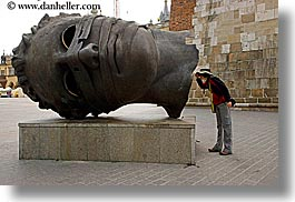 arts, emotions, europe, heads, horizontal, humor, krakow, looking, lori, poland, statues, photograph