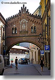 archways, bridge, buildings, europe, krakow, over, poland, streets, vertical, photograph