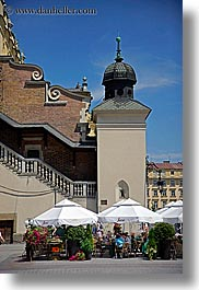 buildings, domes, europe, krakow, onions, poland, restaurants, umbrellas, vertical, photograph