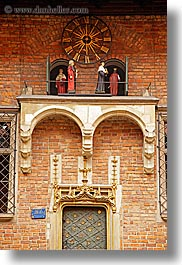 bricks, clocks, europe, gothic, jagiellonian university, krakow, materials, poland, puppets, style, vertical, photograph