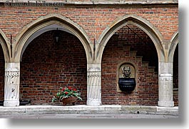 archways, bricks, europe, flowers, gothic, horizontal, jagiellonian university, krakow, materials, poland, red, structures, style, photograph