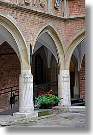 archways, bricks, europe, flowers, gothic, jagiellonian university, krakow, materials, poland, red, structures, style, vertical, photograph