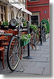 bicycles, cafes, europe, krakow, poland, transportation, vertical, photograph