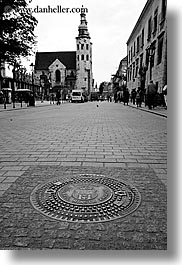 black and white, churches, covers, europe, krakow, manholes, poland, vertical, photograph