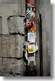 europe, fliers, krakow, pipes, poland, torn, vertical, photograph