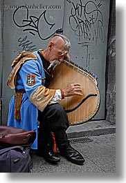 artists, europe, harp, krakow, men, musicians, odd, people, playing, poland, vertical, photograph