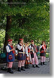 bands, europe, krakow, men, people, poland, polka, vertical, photograph