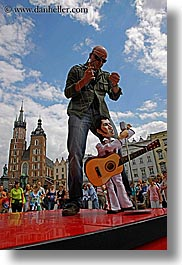 arts, bald, dolls, elvis, europe, krakow, men, people, poland, puppeteers, puppets, vertical, photograph