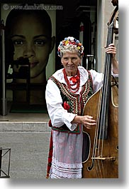 artists, bass, emotions, europe, instruments, krakow, music, musicians, people, poland, smiles, standup, vertical, womens, photograph
