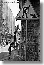 black and white, emotions, europe, humor, krakow, ladder, people, poland, signs, vertical, womens, photograph