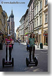 europe, krakow, people, poland, segways, transportation, vertical, womens, photograph