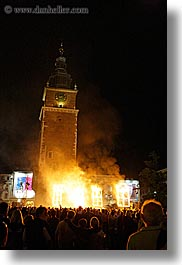 bell towers, buildings, clock tower, crowds, europe, fire, krakow, nite, people, performance, poland, smoke, structures, vertical, photograph