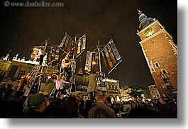 bell towers, buildings, clock tower, crowds, europe, horizontal, krakow, metalic, nite, people, performance, poland, sailing, ships, structures, photograph