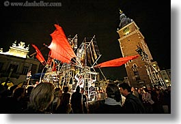 bell towers, buildings, clock tower, crowds, europe, horizontal, krakow, nite, people, performance, poland, red, ships, structures, winged, photograph