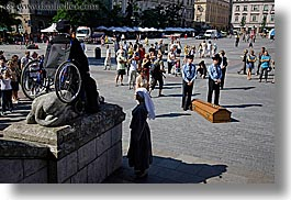 crowds, europe, horizontal, krakow, men, nuns, people, performance, poland, wheel chair, photograph
