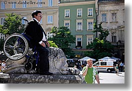 crowds, emotions, europe, horizontal, humor, krakow, lions, men, people, performance, poland, stones, wheel chair, photograph