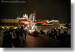 crowds, europe, horizontal, krakow, nite, people, performance, poland, red, ships, winged, photograph