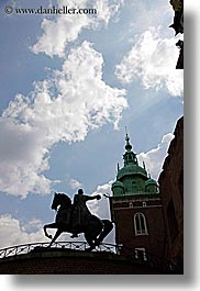 arts, bell towers, buildings, clouds, europe, horses, krakow, poland, silhouettes, statues, steeples, structures, vertical, wawel castle, photograph