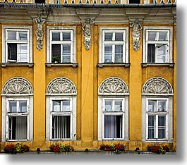 colorful, colors, europe, flowers, horizontal, krakow, oranges, poland, walls, windows, yellow, photograph