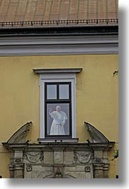 christian, colors, europe, from, krakow, poland, popes, religious, vertical, waving, windows, yellow, photograph