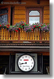 buildings, clocks, europe, flowers, poland, vertical, zakopane, photograph