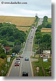 cars, colors, europe, fields, green, highways, roads, slovakia, streets, traffic, transportation, vertical, photograph