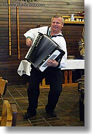 accordion, artists, clothes, dancing, emotions, europe, hats, instruments, music, musicians, people, players, slovakia, slovakian dance, smiles, vertical, photograph