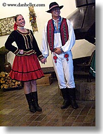 activities, clothes, couples, dance, dancing, emotions, europe, folks, hats, music, people, slovak, slovakia, slovakian dance, smiles, vertical, photograph