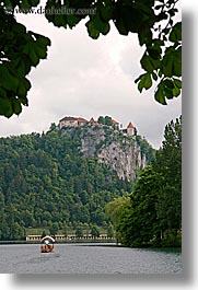 bled, boats, castles, europe, lakes, rowing, slovenia, vertical, photograph