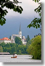 bled, boats, churches, europe, lakes, rowing, slovenia, vertical, photograph