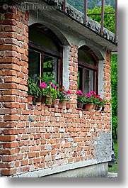 bohinj, bricks, europe, flowers, geraniums, pink, slovenia, vertical, windows, photograph