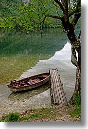 boats, bohinj, branches, europe, lakes, piers, slovenia, trees, vertical, water, photograph