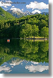 bohinj, canoes, europe, fishermen, lakes, mountains, reflections, slovenia, snowcaps, vertical, water, photograph