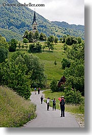 churches, dreznica, europe, hikers, hiking, paths, paved, people, slovenia, vertical, photograph