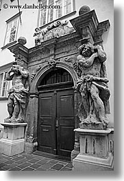 arts, black and white, doors, europe, greek, ljubljana, sculptures, slovenia, statues, stones, vertical, photograph