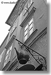 arts, black and white, buildings, europe, hangings, irons, ljubljana, slovenia, teapots, vertical, windows, photograph