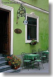 cafes, europe, flowers, green, lamp posts, ljubljana, slovenia, vertical, walls, windows, photograph