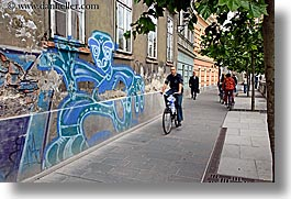 arts, bicycles, biking, cyclists, europe, graffiti, horizontal, ljubljana, people, slovenia, photograph