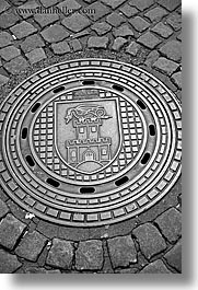 black and white, europe, ljubljana, manhole covers, manholes, slovenia, vertical, photograph