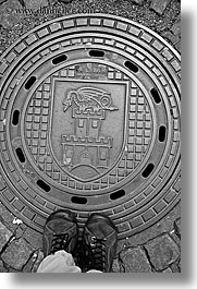 black and white, europe, feet, ljubljana, manhole covers, manholes, slovenia, vertical, photograph