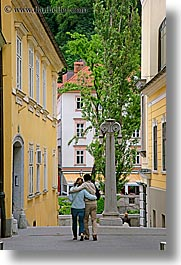 couples, europe, ljubljana, men, people, slovenia, vertical, walking, womens, photograph
