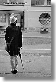black and white, europe, ljubljana, men, people, slovenia, standing, umbrellas, vertical, photograph