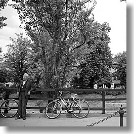 bicycles, black and white, europe, ljubljana, men, people, slovenia, square format, trees, photograph