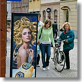 bicycles, europe, humor, ljubljana, people, posters, slovenia, square format, womens, photograph