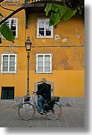 bicycles, cyclists, europe, lamp posts, ljubljana, slovenia, towns, vertical, windows, photograph