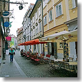 cafes, cities, europe, ljubljana, narrow, pedestrians, slovenia, square format, streets, towns, umbrellas, walk, photograph