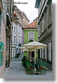 cafes, cities, europe, ljubljana, narrow, slovenia, streets, towns, umbrellas, vertical, photograph