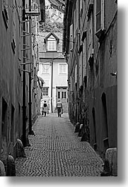 black and white, cities, couples, europe, ljubljana, narrow, slovenia, streets, towns, vertical, walking, photograph