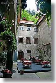 buildings, cafes, courtyard, europe, ljubljana, plants, slovenia, towns, vertical, photograph
