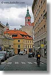 bicycles, buildings, cities, clouds, cyclists, europe, ljubljana, slovenia, streets, towns, vertical, photograph